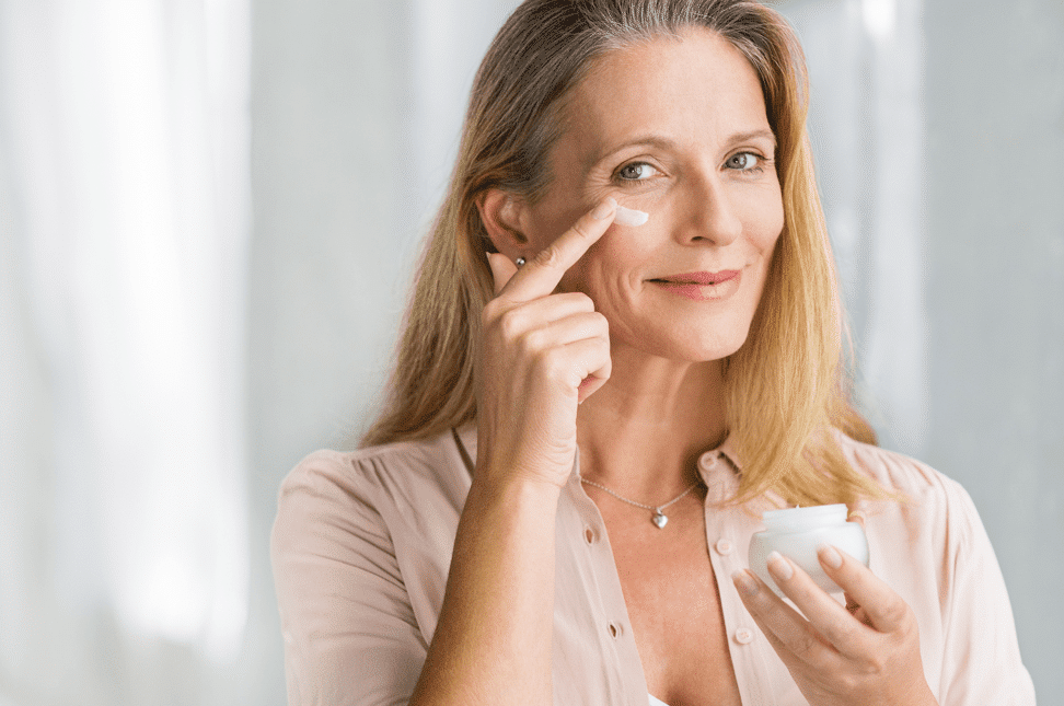 woman applying anti aging cream to face